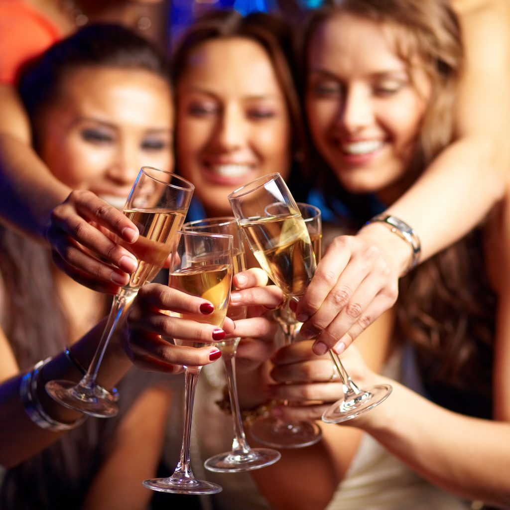 image of 3 women toasting with champagne glasses